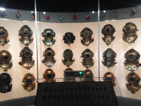 The Wall of Diving Helmets at the History of Diving museum