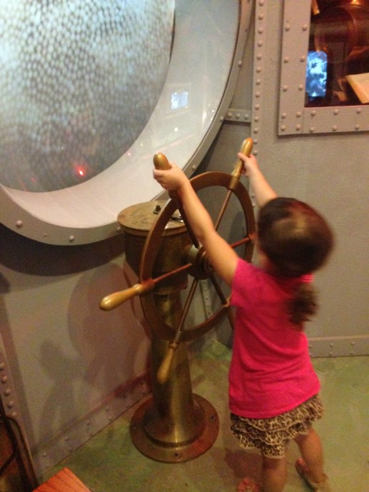 Steering the ship at the History of Diving museum